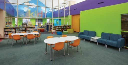 Mini Mobile tables with orange chairs shown in library setting