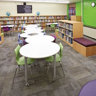 White Mini Mobile flip-top tables in library setting