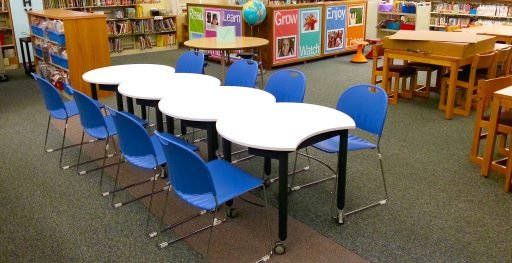 Mini Mobile tables with blue chairs shown in library setting