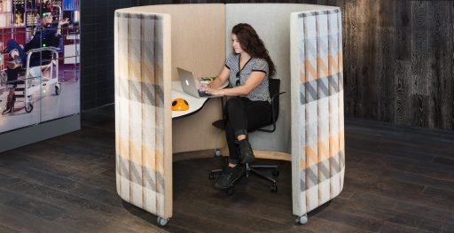 Woman works in complete privacy from a Waltzer workstation from Muzo
