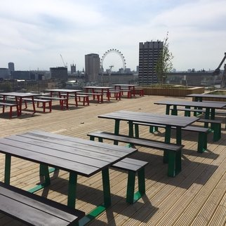 Muzo's Edge tables and benches in rooftop setting