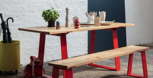 Edge table and bench set with red details used in kitchen