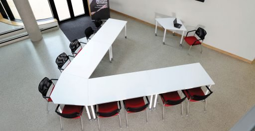 Muzo's Kite table shown in meeting room