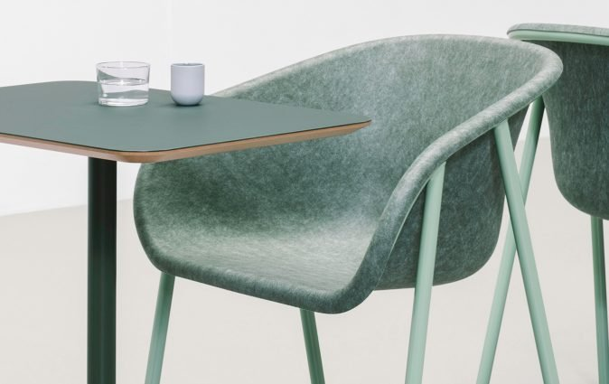 LJ1 shell chair made from PET felt pictured at table