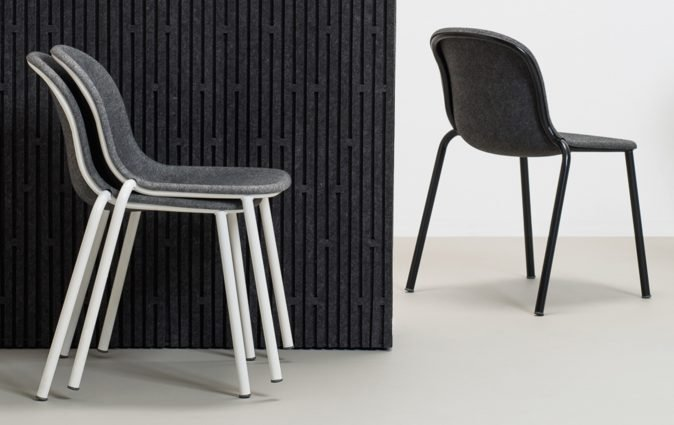Stacked LJ2 chairs stored neatly and discreetly thanks to smart 3D pressing technology