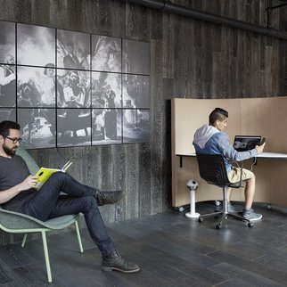 Man relaxes in Nook lounge chair in office setting
