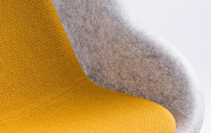 Close up of ultra comfortable Nook lounge chairs in yellow and grey
