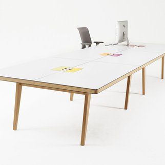 Osprey contemporary tables and benches with power and data integration options