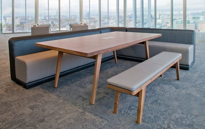 Muzo's Osprey table and bench pictured in upmarket lounge