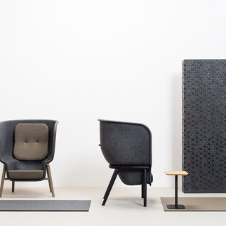 Front and side views of Muzo's M-Pod PET felt privacy chair