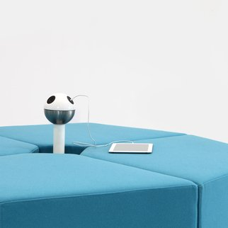 Muzo's Powerball standing charging unit in modular seating system