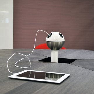 Muzo's Powerball standing charging unit charging tablet on table