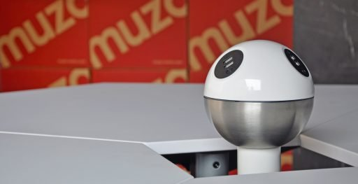 Muzo's Powerball standing charging station shown at the centre of table