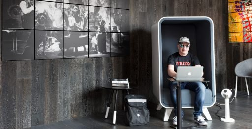 Man works from a laptop in grey Box Lounger from Muzo