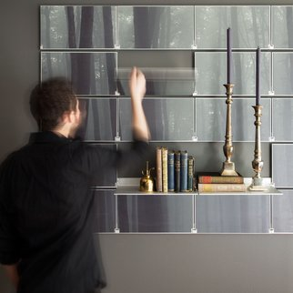 Man unfolds Riveli wall shelving system