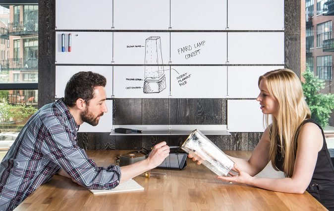 Colleagues talk product design using Riveli whiteboard