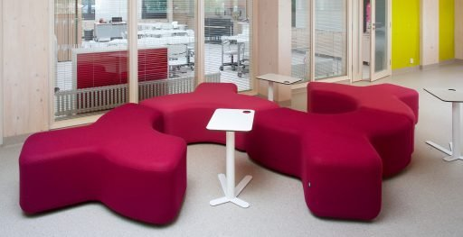 Berry red Signs modular seating system pictured in office with side tables