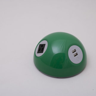A Desktop Powerball charging unit in green
