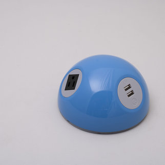 A Desktop Powerball charging unit in blue