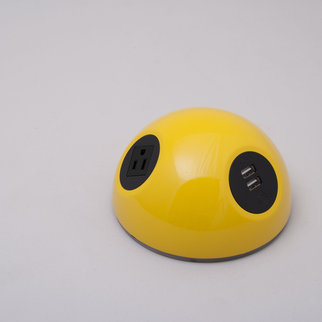 A Desktop Powerball charging unit in yellow