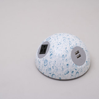 A Desktop Powerball charging unit with creative water droplet design