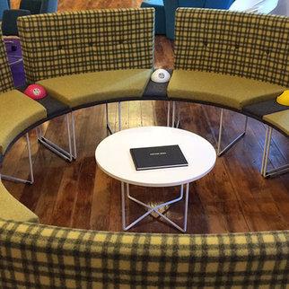 Muzo's Desktop Powerball charging units shown in circular seating area