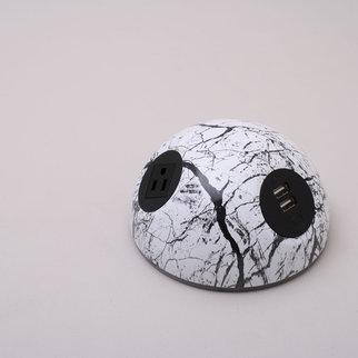 A Desktop Powerball charging unit with creative monochrome design