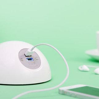 Desktop Powerball unit charging smartphone