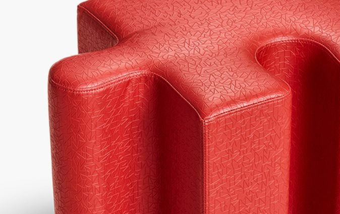 Close up of Muzo's red Puzzle seating single piece