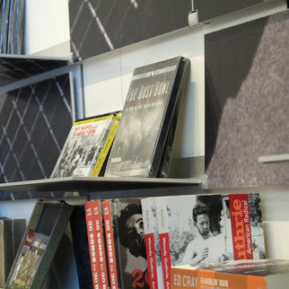 Close up of Muzo's Woody Guthrie shelving system