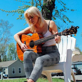 Performer Beth McCarthy plays guitar