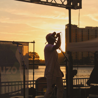 Performance at sunset during Muzo live music event