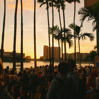 Crowd at sunset during Muzo live music event