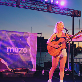Artist performs Muzo live music event