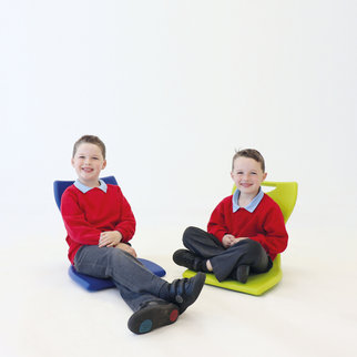 Children sit on MBob floor chairs