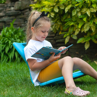 Girl enjoys her favourite book while sitting on the MBob