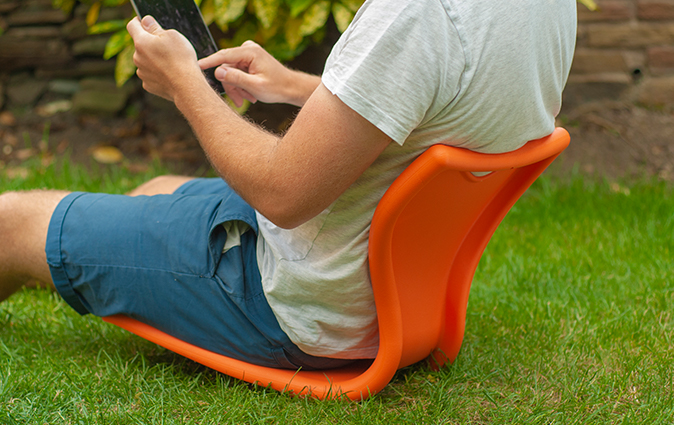 Man uses an MBob floor seat in his garden