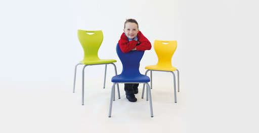 Child with MBob chair in royal blue, lime green and banana yellow