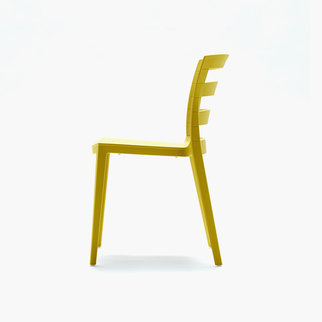 Side view of yellow Muzo Town chair