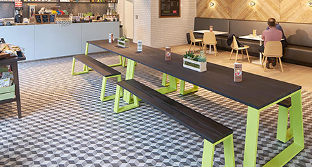 Muzo Block tables and benches used in a cafeteria