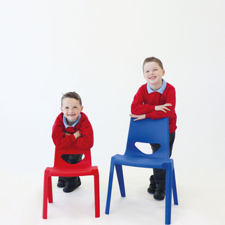 Two children leaning on K-seat chairs