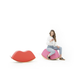 Girl listening to music while sitting on the Lips rocker