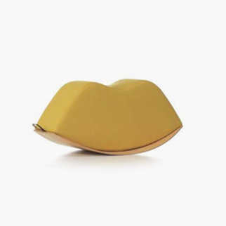 A yellow Lips soft rocker seat