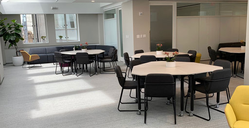 A training room at LVMH furnished with Kite tables
