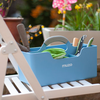 A Muzo Stashbox with garden tools