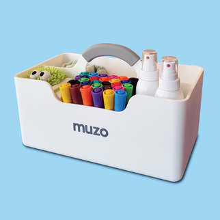 A Muzo Stashbox full of art supplies