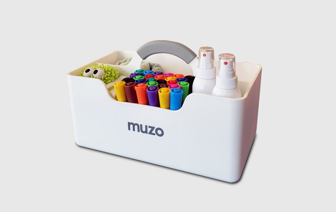 The Muzo Stashbox filled with art supplies