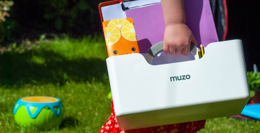 Child carries Muzo Stashbox in garden