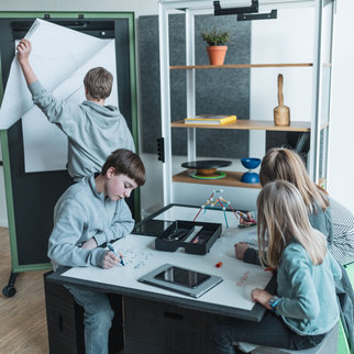 Students hard at work using the Xbrick in a multifunctional space
